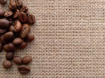 Coffee grains on byurlap. Available surface. stock photography