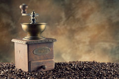 Coffee grains and coffee grinder Stock Images