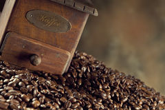 Coffee grains and coffee grinder Royalty Free Stock Photo