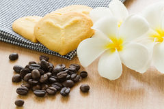 Coffee grains with cookie and plumeria flower Stock Photo