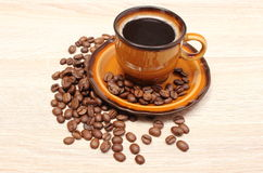 Coffee grains and cup of beverage Stock Image