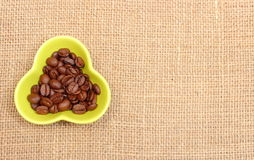 Coffee grains in cup and copy space for text Stock Photos