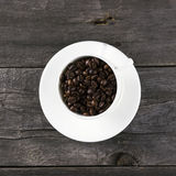 Coffee grains on dark wooden background Royalty Free Stock Photos