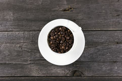 Coffee grains on dark wooden background Royalty Free Stock Images