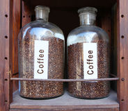 Coffee grains in glass vessels Stock Image