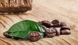 Coffee grains and green leaf Stock Photo