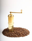 Coffee grains with grinder Stock Photos