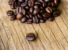 Coffee grains on grunge wooden Royalty Free Stock Photos