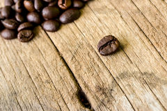 Coffee grains on grunge wooden Royalty Free Stock Images