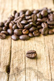 Coffee grains on grunge wooden Stock Photo