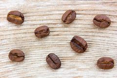 Coffee grains. On grunge wooden background Royalty Free Stock Photography