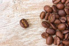 Coffee grains. On grunge wooden background Stock Photo