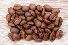 Coffee grains. On grunge wooden background Royalty Free Stock Photo