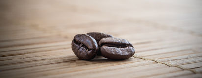 Coffee grains on grunge wooden background royalty free stock photography