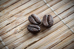Coffee grains on grunge wooden background stock photo