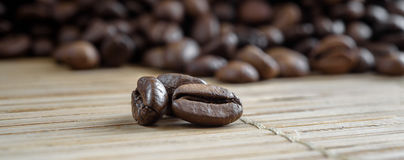 Coffee grains on grunge wooden background stock photography