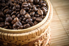 Coffee grains on grunge wooden background stock images