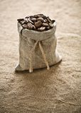 Coffee Grains In Bag On Sacking Royalty Free Stock Photo