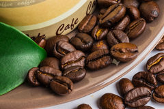 Coffee grains and leaves Stock Photos