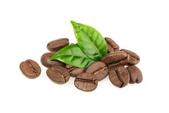 Coffee grains and leaves isolated Stock Photos