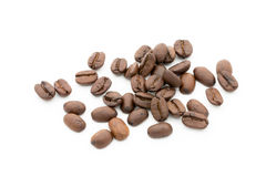 Coffee grains and leaves isolated on the white backgrounds. Royalty Free Stock Image