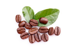 Coffee grains and leaves on white background royalty free stock photos