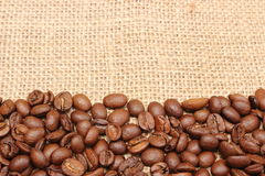 Coffee grains lying on jute canvas Royalty Free Stock Photos