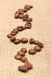 Coffee grains on old fabric Stock Photo