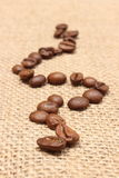 Coffee grains on old fabric Royalty Free Stock Photo