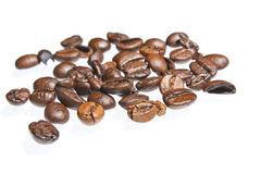 Coffee grains over white background Royalty Free Stock Image