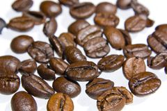 Coffee grains over white background Stock Photo