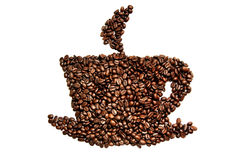 Coffee grains in the shape of a cup of coffee on a white Royalty Free Stock Photos