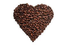 Coffee grains in the shape of a heart on a white background Royalty Free Stock Photos