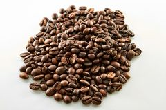 Coffee grains slide isolated on white stock photography