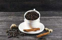 Coffee grains, sugar, cinnamon on dark wooden background Royalty Free Stock Image