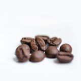 Coffee grains on white background Stock Photos