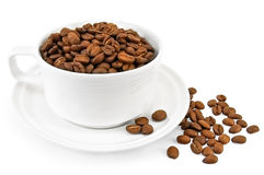 Coffee grains in a white cup on the table Royalty Free Stock Image