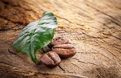 Coffee grains on wooden background Royalty Free Stock Photos