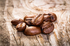 Coffee grains on wooden background. Stock Photos