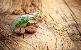 Coffee grains on wooden board Stock Photography