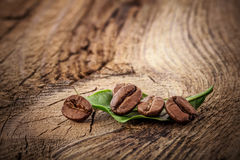 Coffee grains on wooden board Royalty Free Stock Photo