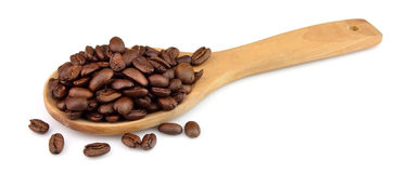 Coffee grains on a wooden spoon Stock Photo