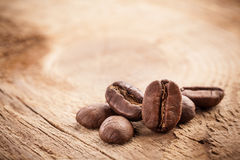 Coffee grains on wooden table Stock Image