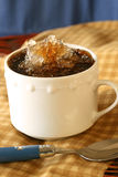 Coffee Granita. Ice coffee granita in white cup with spoon and blue background Stock Photography