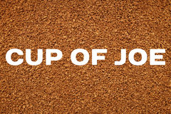 Coffee granules background with CUP OF JOE concept text Stock Photos