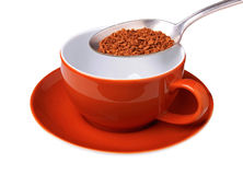 Coffee granules and cup Stock Photos