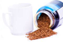 Coffee granules and mug. Instant coffee granules from jar and coffee mug Royalty Free Stock Photo