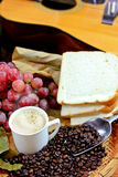 Coffee with grapes and bread Stock Images