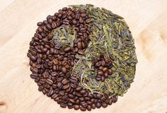 Coffee and Green Tea in Yin yang symbol. Concept for tonic beverages Royalty Free Stock Photos
