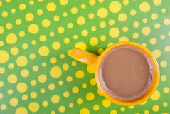 Coffee in green and yellow setting Royalty Free Stock Photos